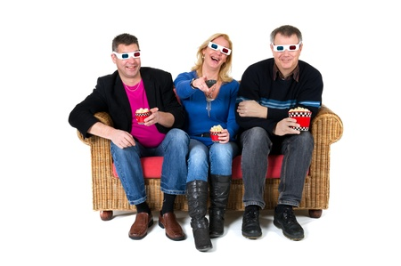 Three persons are laughing about the 3D movie on televison photo