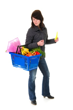 shopping blond woman in the supermarket with basket  photo
