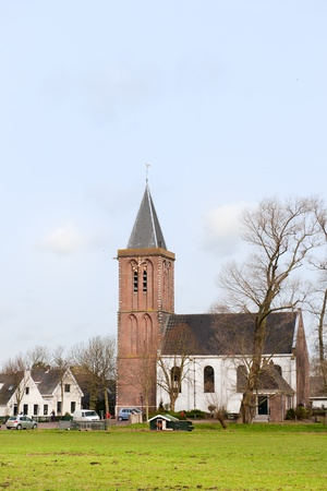 Typical Dutch agraric village with church and farm houses Stock Photo - 8991611
