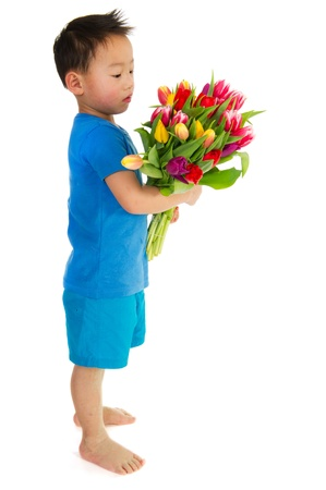 asian tulips: Asian boy with a colorful bouquet tulips