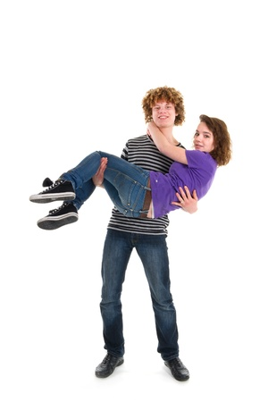Young boy with curly hair is carrying his girl friend Stock Photo - 8991500