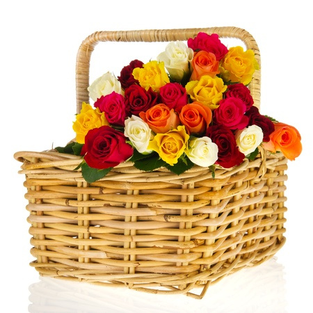 Colorful bouquet roses in basket isolated on white background photo