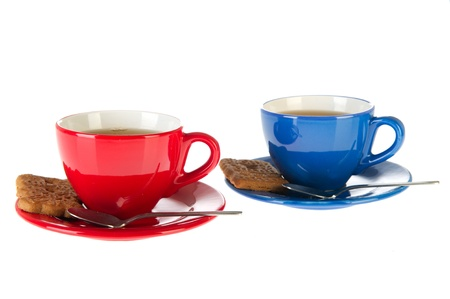 speculaas: Cups of tea with cookies in red and blue  Stock Photo