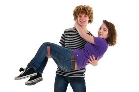 Young boy with curly hair is carrying his girl friend 版權商用圖片