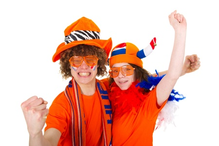 Young couple in orange outfit is supporting the Dutch soccer team photo