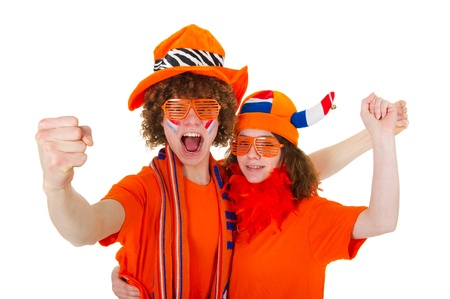 Young couple in orange outfit is supporting the Dutch soccer team Stock Photo - 9053948