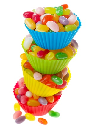 cup four: Colorful cups full with jelly beans isolated over white background