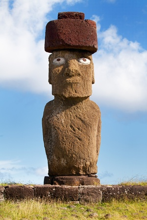 moai: Single Moai statue in front of blue sky easter island Stock Photo