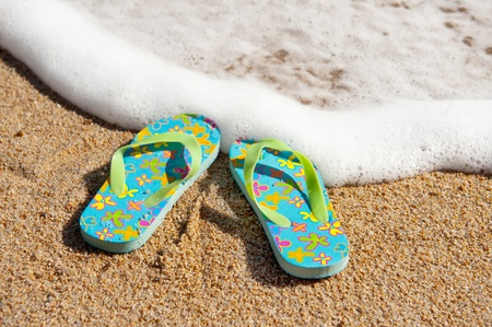 Flip flop sandals at the beach near the water line Stock Photo - 9235107