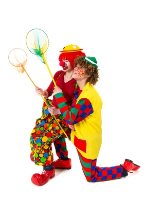 Couple funny full dressed clowns are catching it all photo