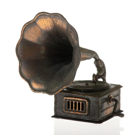 Old grammophone for playing vinyl on white background photo