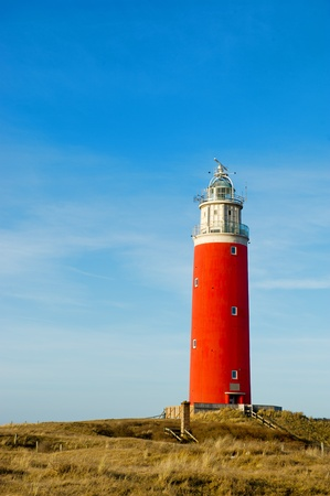 Red lighthouse at the Dutch island Texel Stock Photo - 9235325