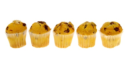 Row chocolate muffins in paper on white background photo