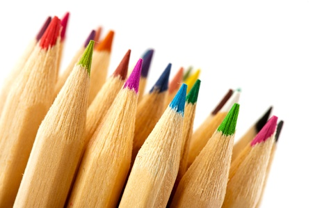 Various wooden color pencils on white background photo