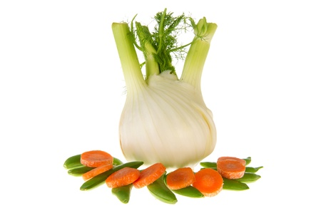 snaps: Isolated fresh fennel with sugar snaps and slices of carrots Stock Photo