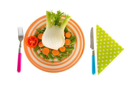 Isolated fresh fennel with sugar snaps, green peas and carrots photo