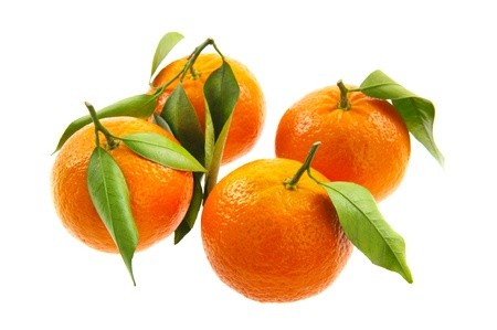 Fresh tangerines with leaves isolated over white photo