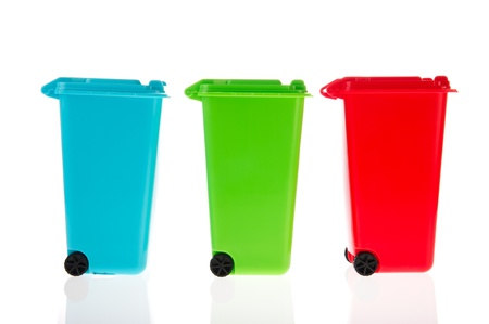 litterbin: Three plastic rolling containers for garbage in a row Stock Photo