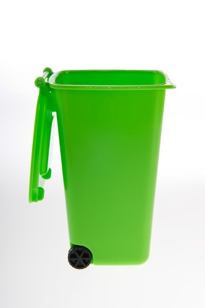 litterbin: Single green plastic roll container for garbage on white background Stock Photo