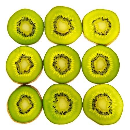 whote: Green slices of transparency kiwi on whote bakcground Stock Photo