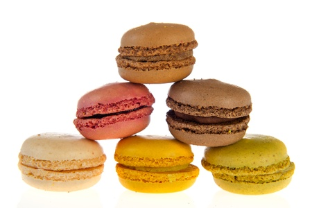 Colorful French macarons isolated over white background photo
