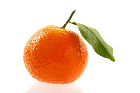 Fresh tangerine with leaves isolated over white photo