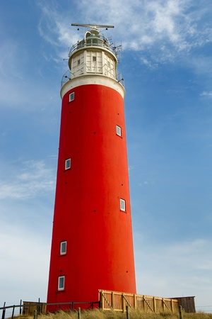Red lighthouse at the Dutch island Texel photo