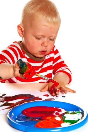 Painting toddler with brush in the studio photo