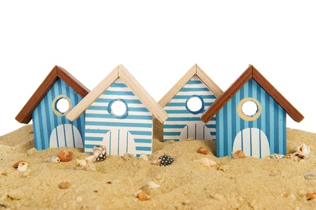 row striped beach huts in the sand photo