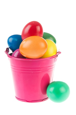 Pink bucket full with colorful painted easter eggs photo
