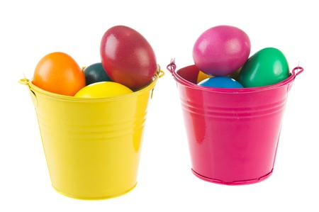 Two buckets full with colorful painted easter eggs photo