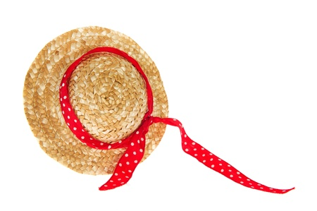 wicker summer hat with red ribbon on white background photo
