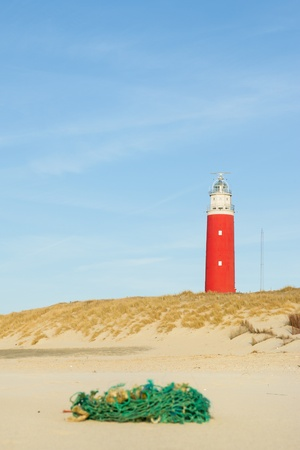Lighthouse in coast landscape at Dutch island Texel Stock Photo - 9414504