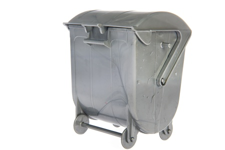 Closed gray industrial garbage container on white background photo