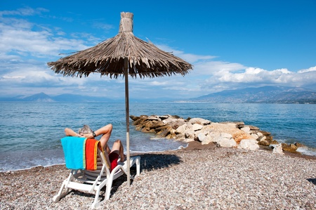 Shade with straw parasol at the beach photo