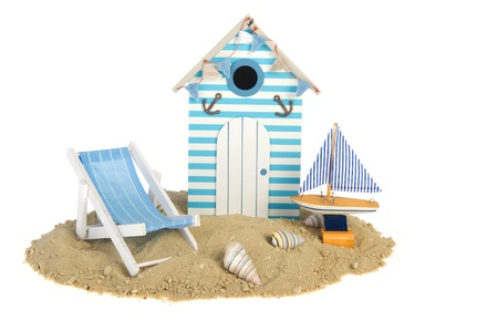 beach hut: Summer beach hut with sailing boat and chair in the sand Stock Photo