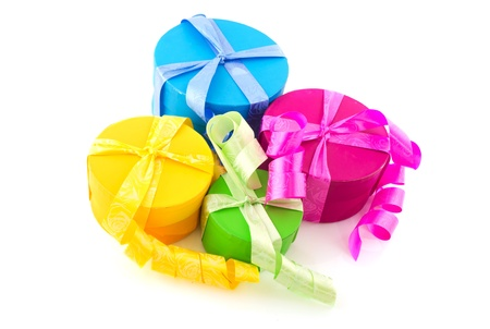 Colorful round boxes with ribbins and bows photo