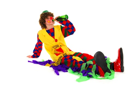 Clown is drinking with a bottle of wine photo