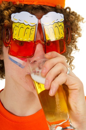 Young Dutch sports fan is drinking beer Stock Photo - 9514797