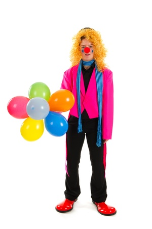 Funny clown in pink with colorful balloons photo