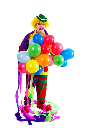 Funny colorful clown with colorful balloons on white background photo
