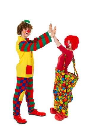 Couple funny full dressed clowns in the studio Stock Photo - 9514765