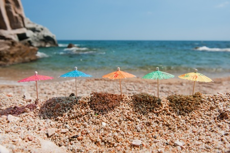 Colorful Chinese paper parasols for shade at the sunny beach photo
