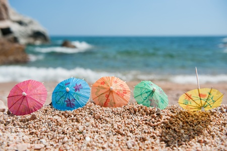 Colorful Chinese paper parasols for shade at the sunny beach Stock Photo - 9514788