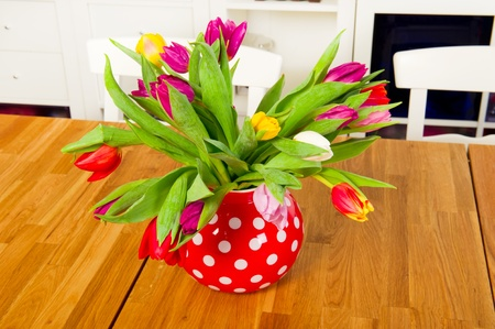 Bouquet colorful tulips in the living room