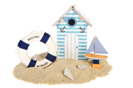 beach buoy: Summer beach hut with sailing boat and life buoy