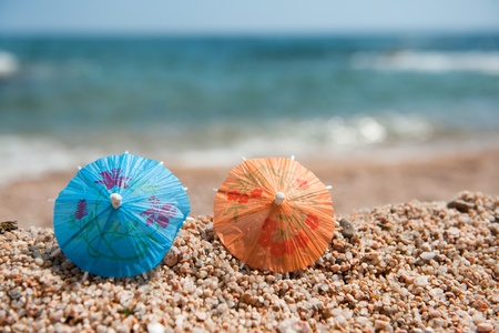 Colorful Chinese paper parasols for shade at the sunny beach Stock Photo - 9593770