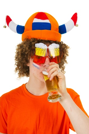 Young Dutch sports fan is drinking beer photo
