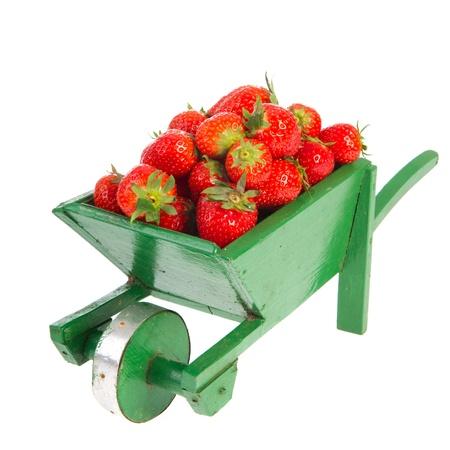 Carretilla con fresas de la huerta Foto de archivo - 9637121