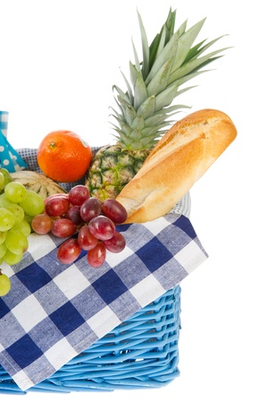 Picnic basket with bread and fresh fruit